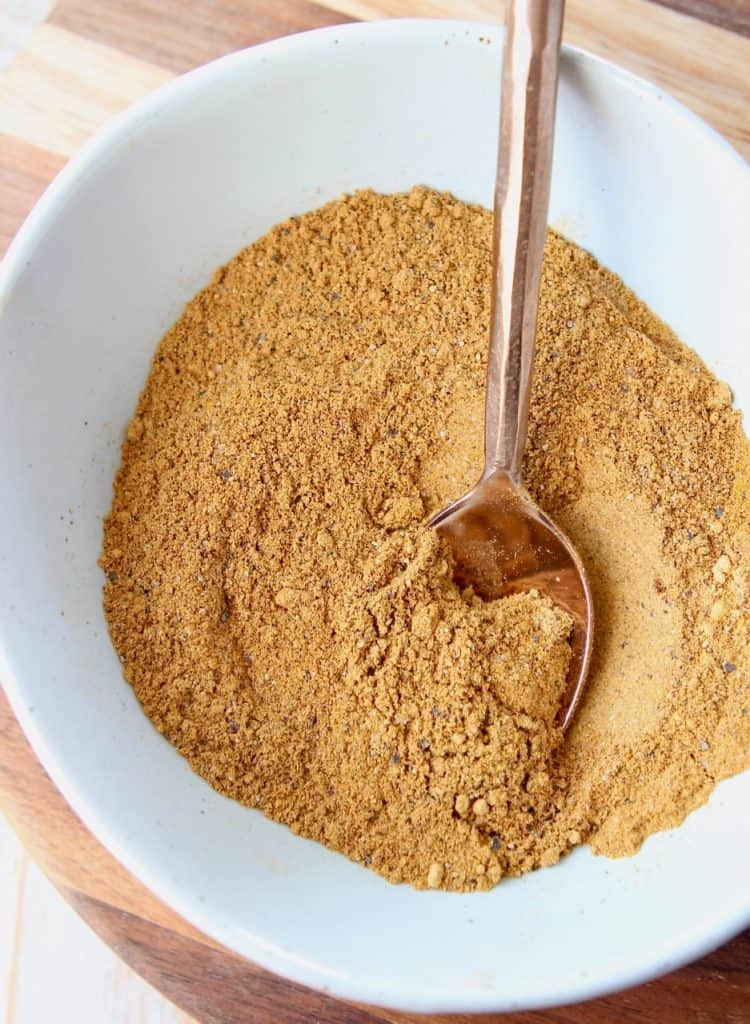 Moroccan seasoning mix in bowl with spoon