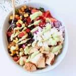 Overhead image of Tex Mex bowl with diced chicken, black beans, tomatoes and cheese