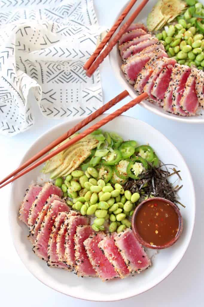 Overhead image of sushi bowls with sliced tuna, jalapenos and edamame