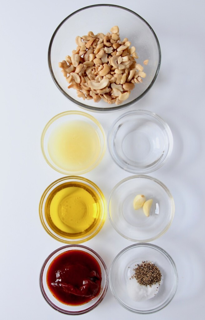 ingredients for cashew chipotle sauce in glass bowls