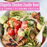 Sliced chicken in bowl topped with avocado tomato salsa
