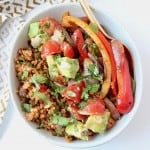 Fajita veggies in bowl with avocado salsa