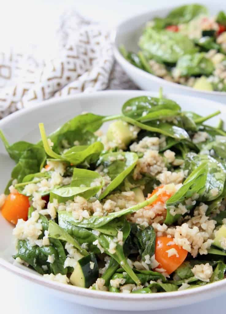 Spinach and cauliflower rice salad in bowl