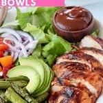 Sliced bbq chicken in bowl with vegetables