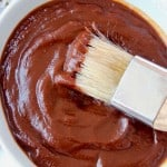 BBQ sauce in bowl with pastry brush