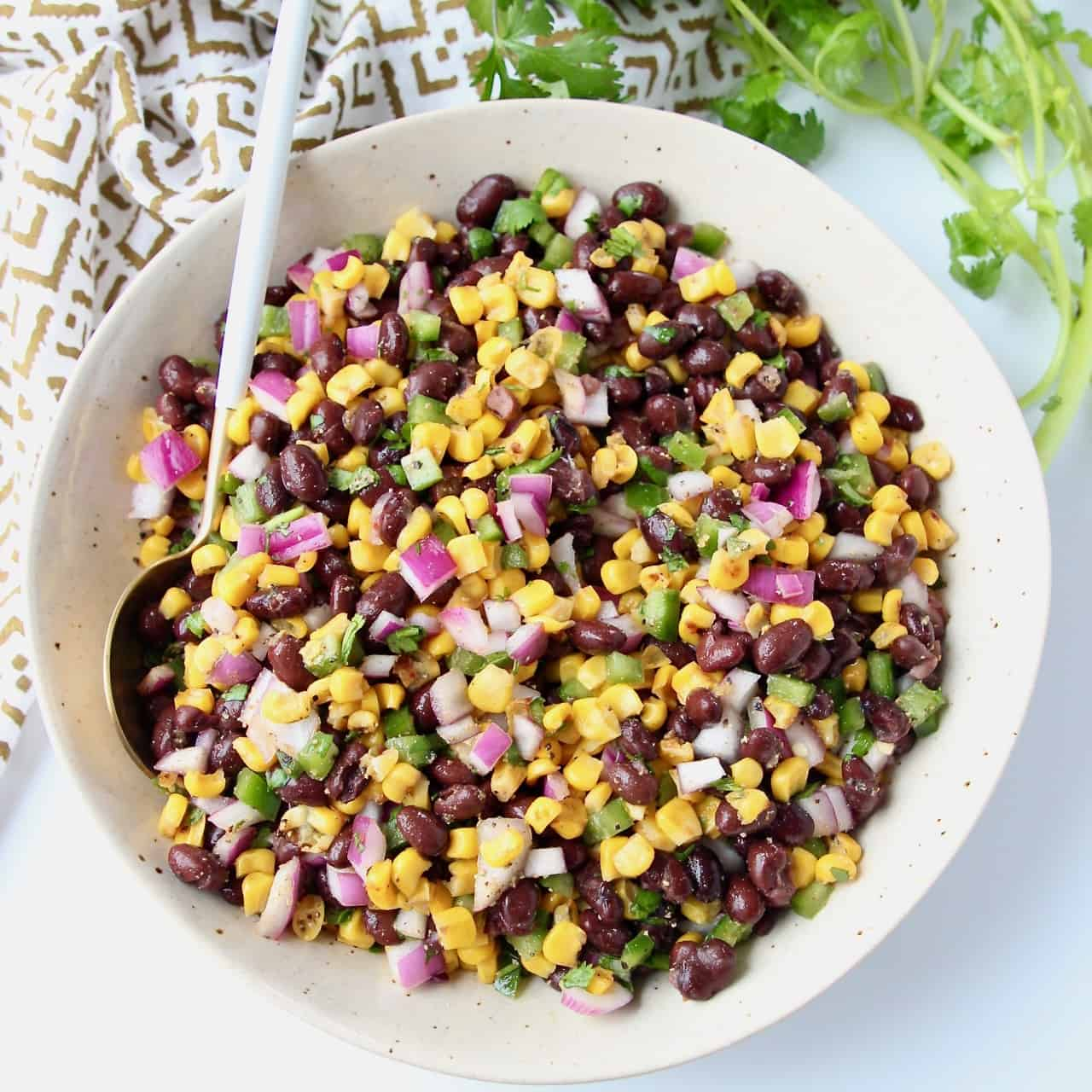 Black beans and corn in bowl with spoon