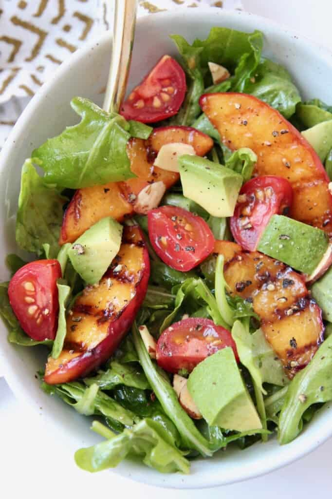 Overhead image of grilled peaches in salad
