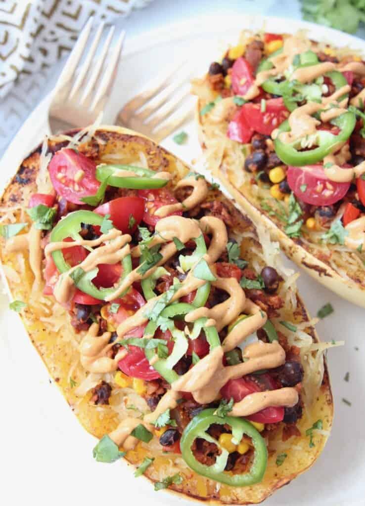 Overhead image of roasted spaghetti squash with burrito filling