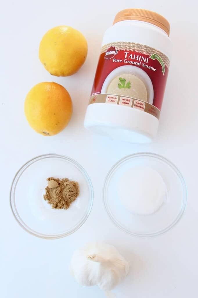 overhead image of ingredients for garlic tahini sauce