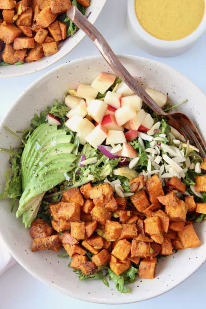 overhead image of sweet potato salad in bowl with fork