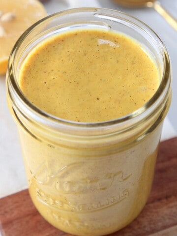 turmeric almond butter salad dressing in mason jar