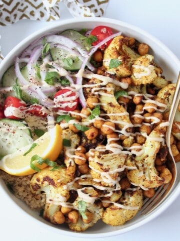 overhead image of cauliflower shawarma bowl with gold fork