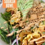 overhead image of roasted squash quinoa bowl drizzled with chipotle sauce