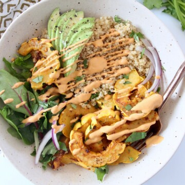 overhead image of roasted delicata squash quinoa bowl