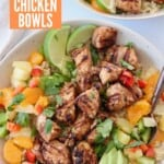 grilled diced jerk chicken in bowl with fresh fruit and vegetables