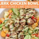 grilled chicken in bowl with honey lime dressing drizzled over the chicken