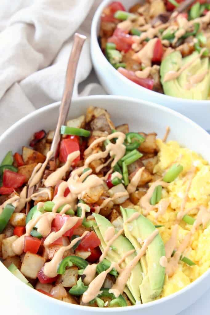 breakfast burrito bowl drizzled with creamy chipotle sauce
