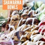 chicken shawarma in bowl drizzled with creamy garlic sauce