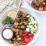 bowl with grilled chicken, diced cucumber and tomatoes