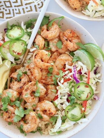 grilled shrimp in bowl with greens