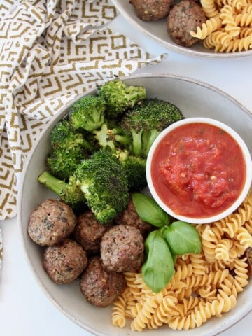 vegan meatballs in bowl with broccoli, rotini and marinara sauce
