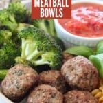 vegan meatballs in bowl with broccoli florets