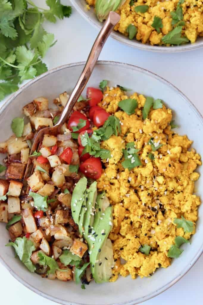 scrambled tofu in bowl with roasted potatoes
