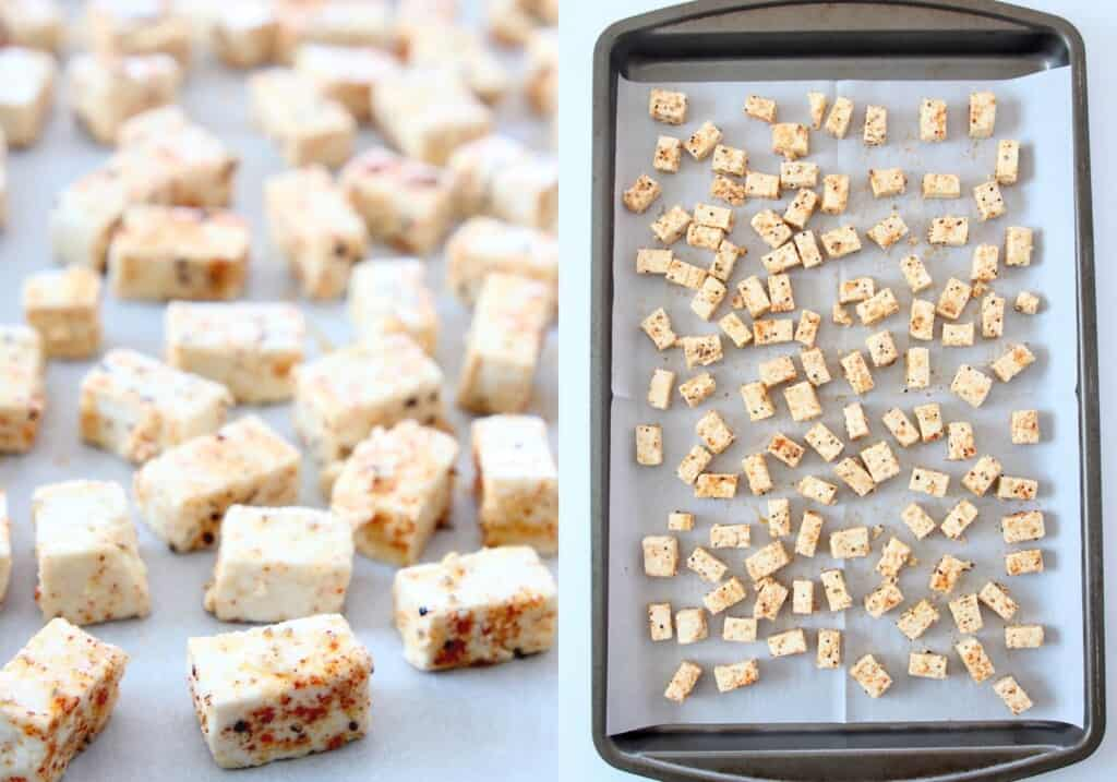 small cubes of seasoned tofu on parchment-lined baking sheet