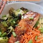 teriyaki glazed salmon in bowl with carrots, broccoli and avocado