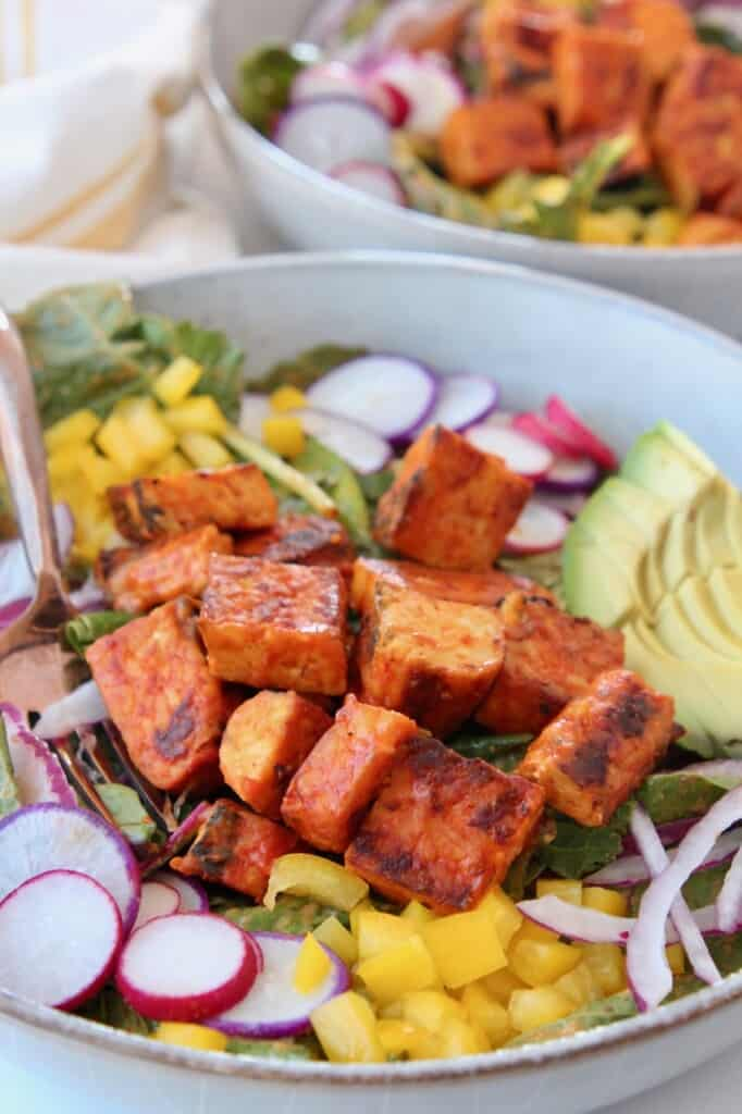salad in bowl topped with cubes of buffalo tempeh