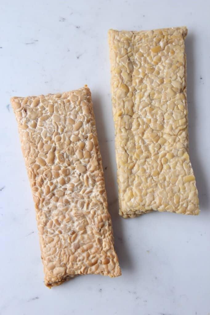 blocks of tempeh on cutting board