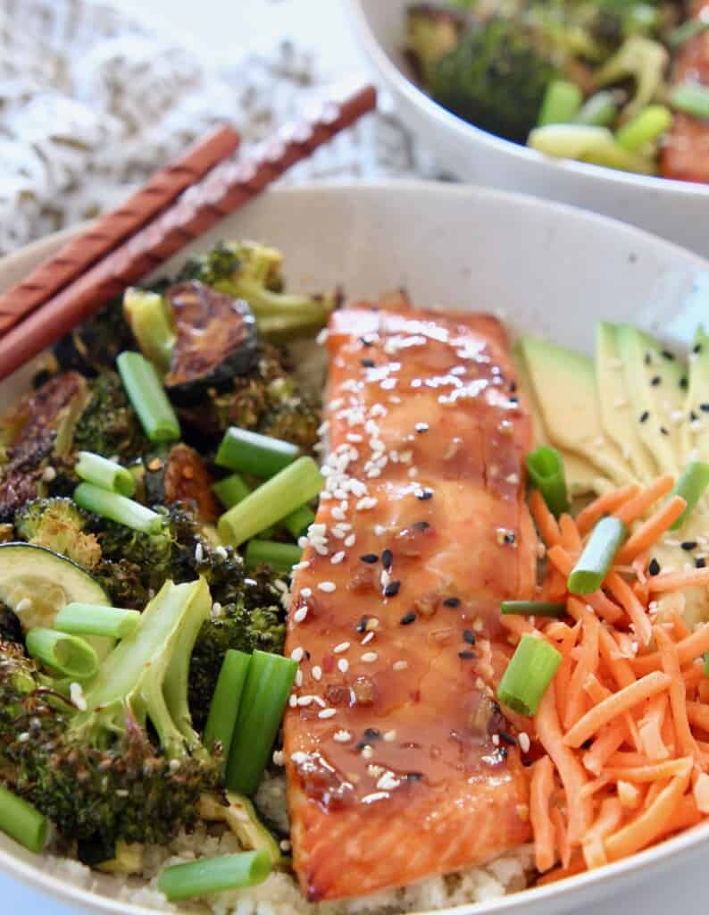 teriyaki salmon in bowl with vegetables and cauliflower rice