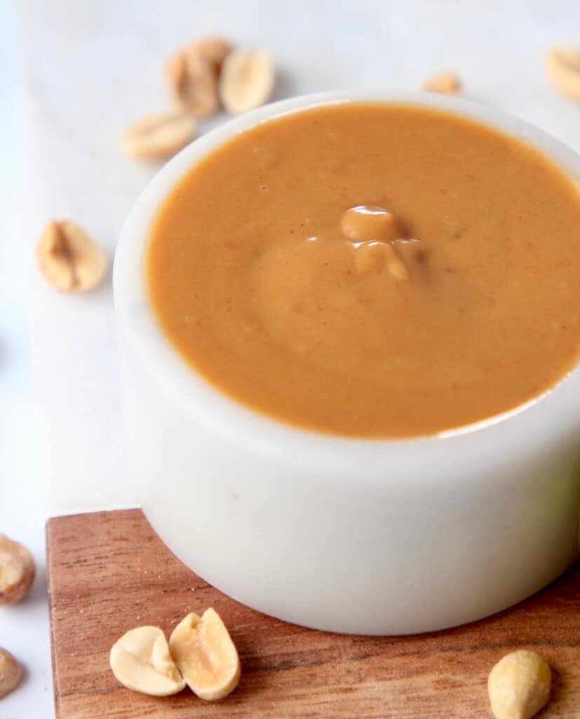 peanut sauce in white bowl