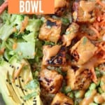 cooked tempeh in bowl with vegetables and peanut sauce