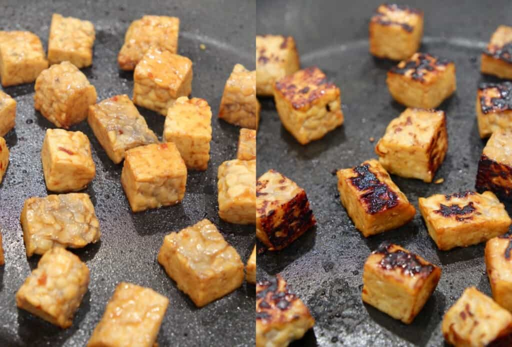 marinated cubes of tempeh cooking in a skillet