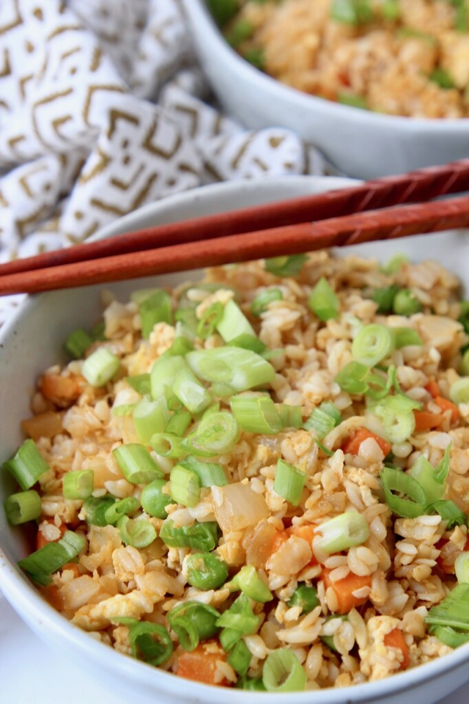fried rice in bowl with chopsticks on the side