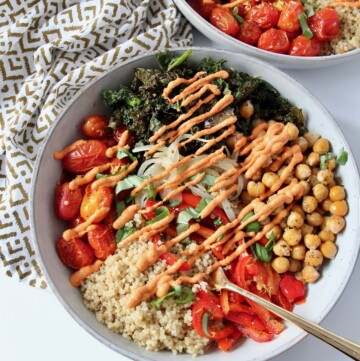 quinoa and roasted vegetables in bowl drizzled with sauce